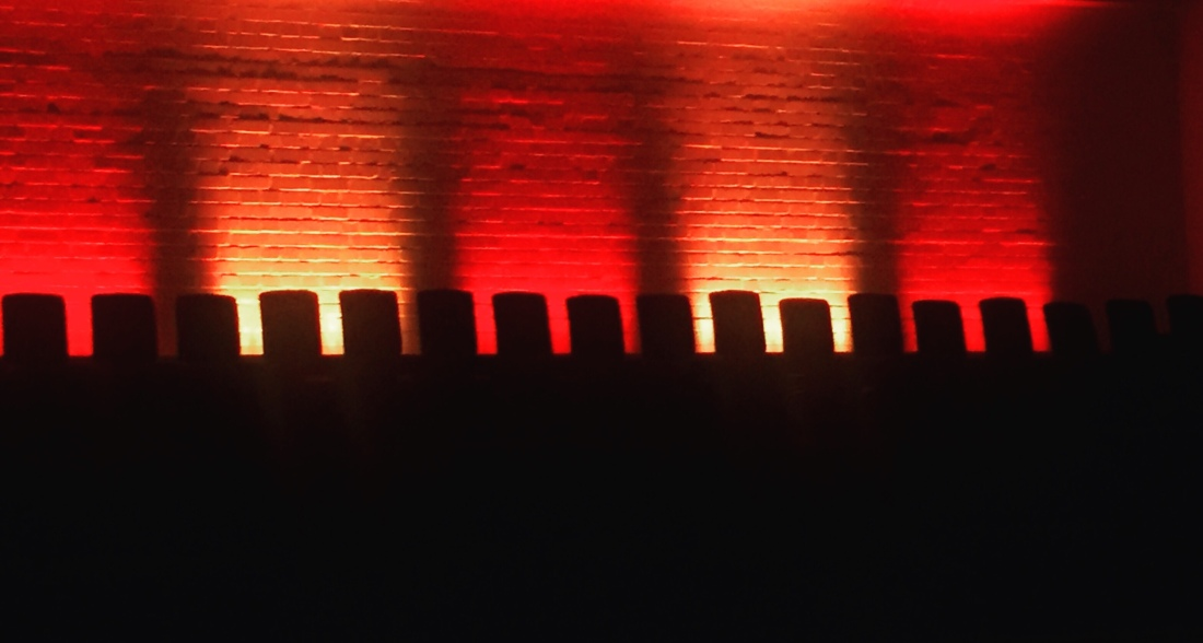 A stage set for a play illuminated in red